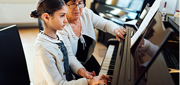 Piano student at her summer lesson.