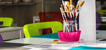 art supplies on a table in a classroom