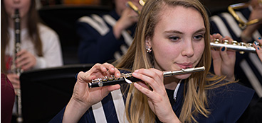 March is Music in Our Schools month! - Student playing piccolo in band class.