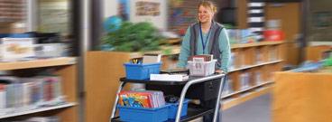 Music teacher pushing a cart
